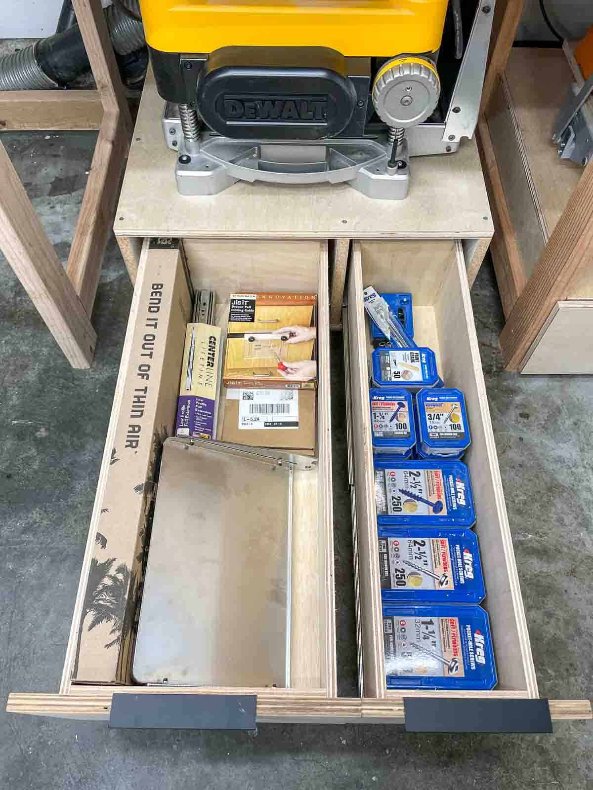 planer stand with drawers pulled out to display screws and other accessories