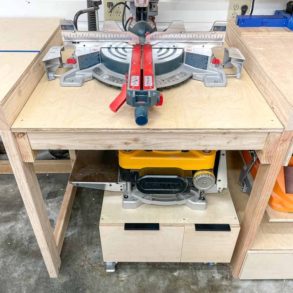 DIY planer stand with drawers under miter saw station