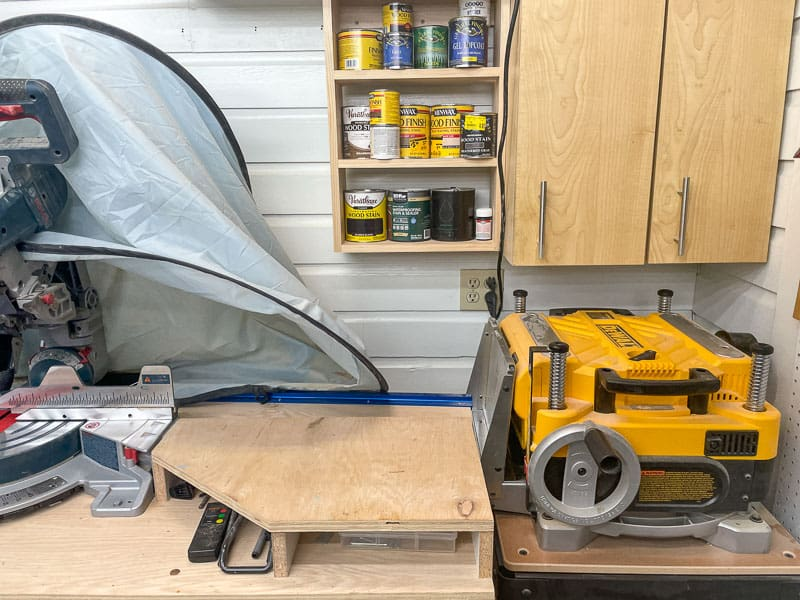 corner of workshop with cabinets,  planer and miter saw stand