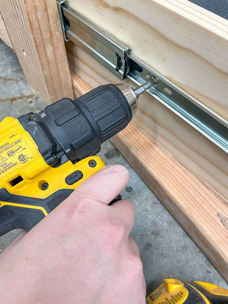 attaching drawer slide to drawer with a drill