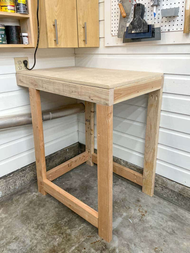 tool stand frame attached to wood paneled walls in workshop