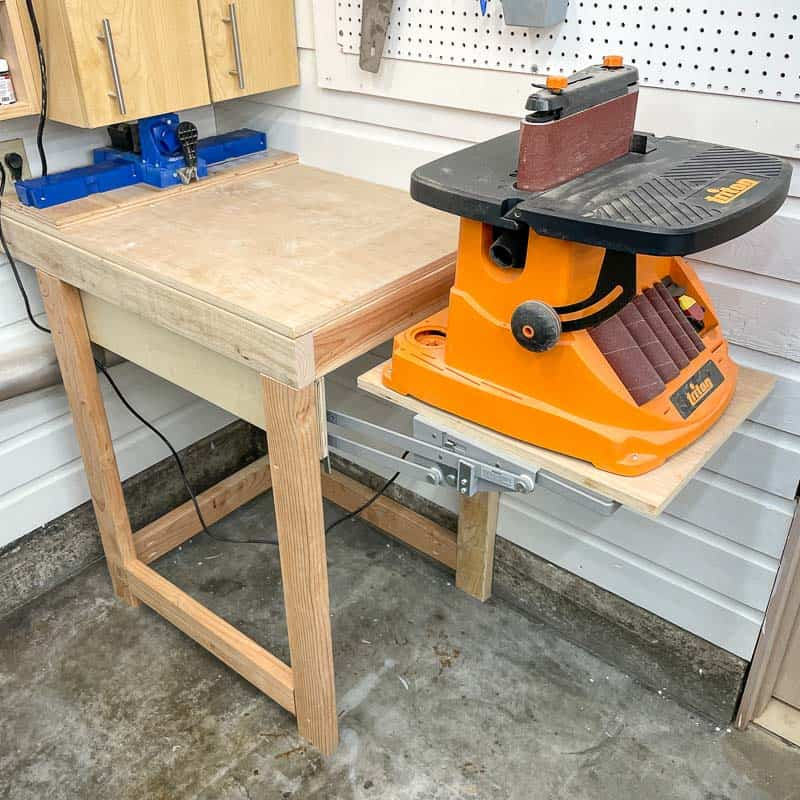 DIY tool stand with mixer lift for sander in raised position
