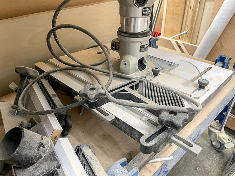 folding router table shoved under workbench