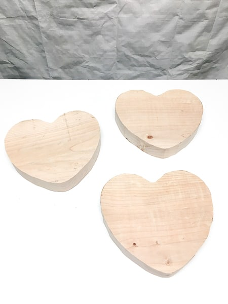 large wooden hearts on workbench