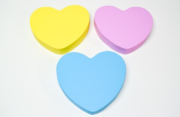 wooden hearts painted to match conversation hearts candies