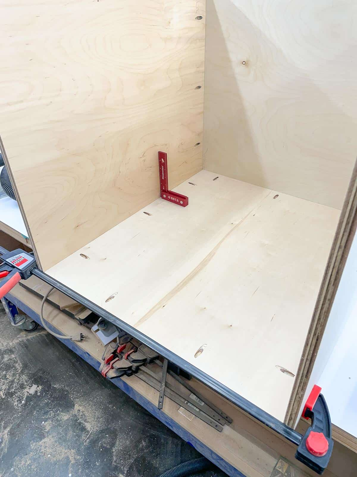 attaching the back of the router table stand to the sides with pocket hole screws
