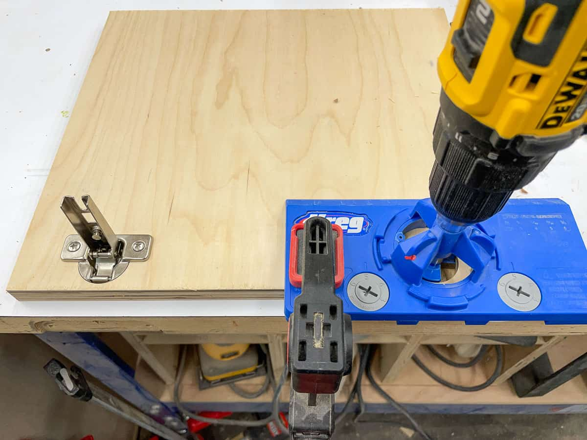 drilling concealed hinge holes in router table cabinet doors with a jig