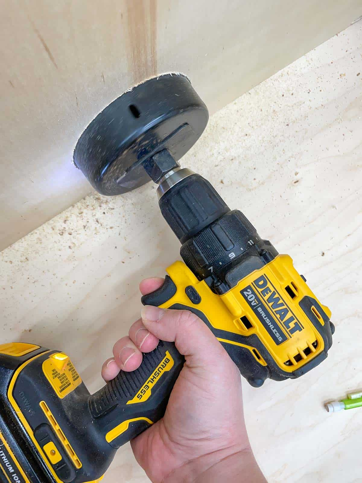 drilling holes for router table dust collection with a hole saw