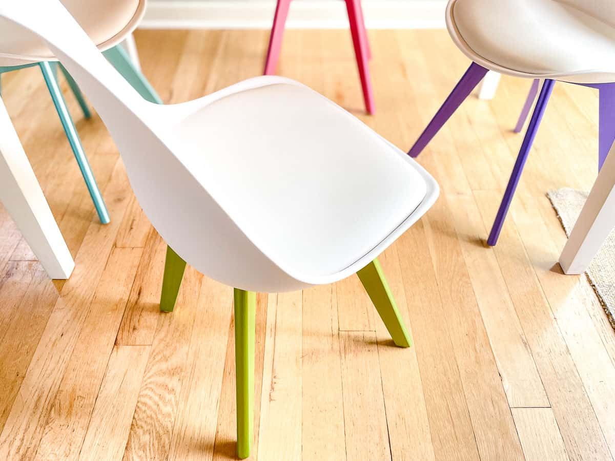midcentury modern chairs with different metallic paint colors