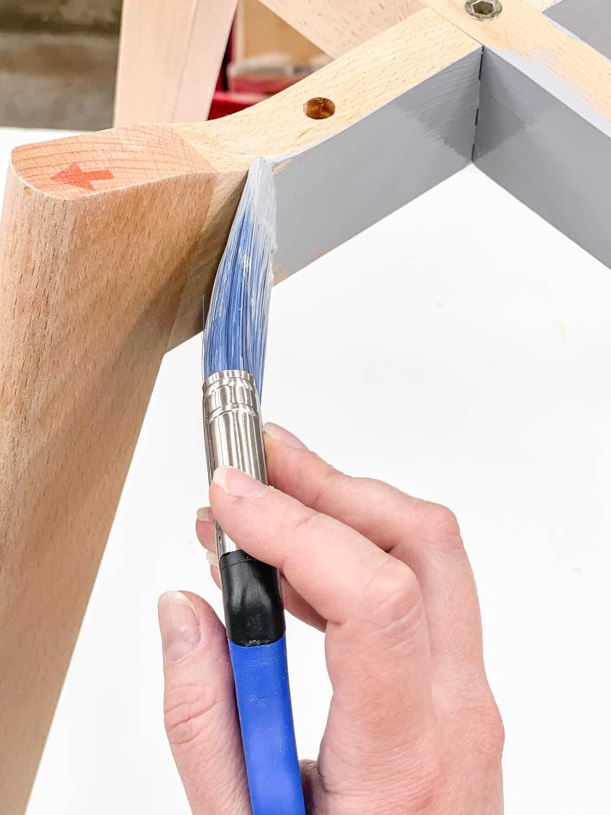 applying cool tone primer to chair base before applying metallic paint