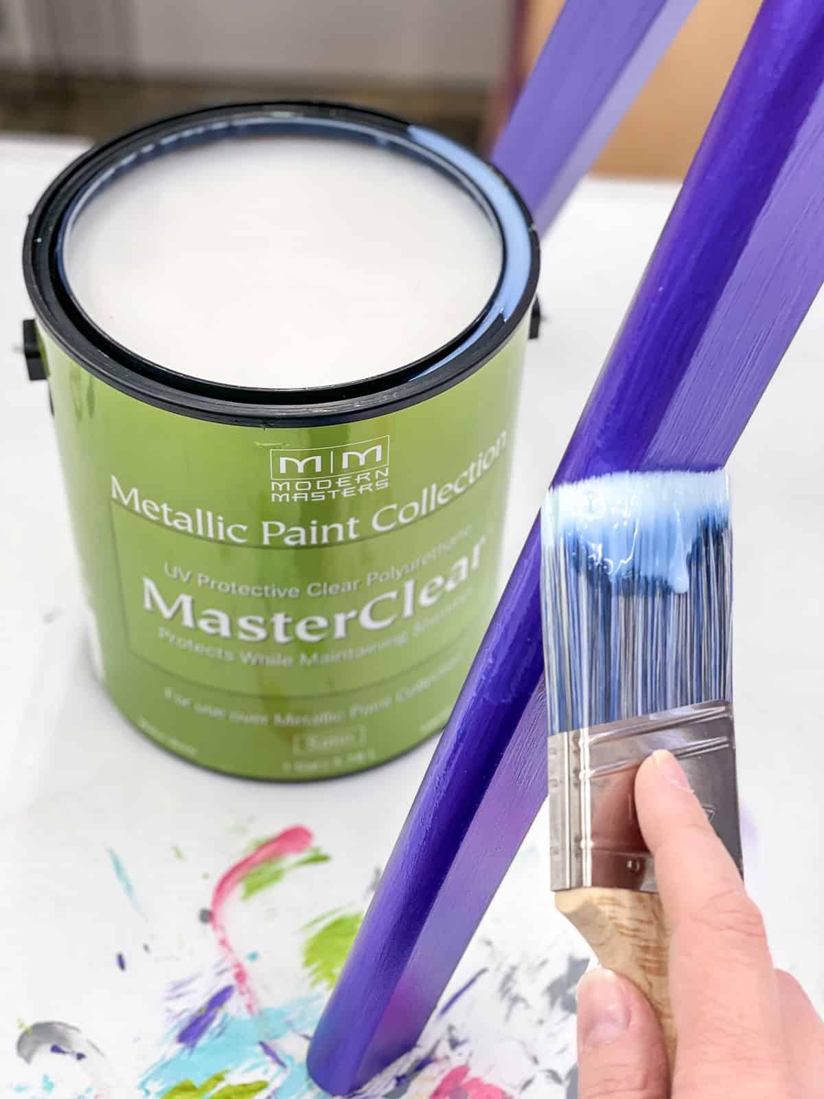 applying Modern Masters MasterClear top coat to purple metallic paint on chair leg