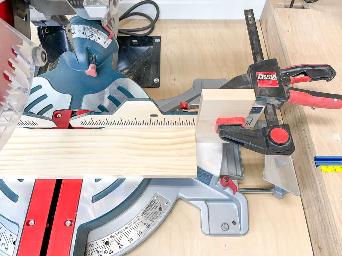miter saw stop block clamped to saw fence