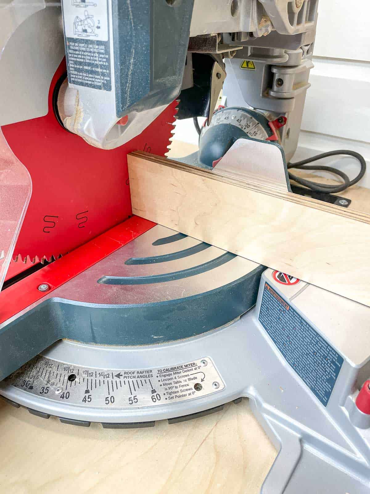 cutting the extension fence on the miter saw