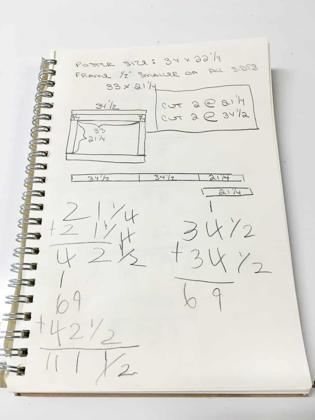 notebook with measurements for poster frame