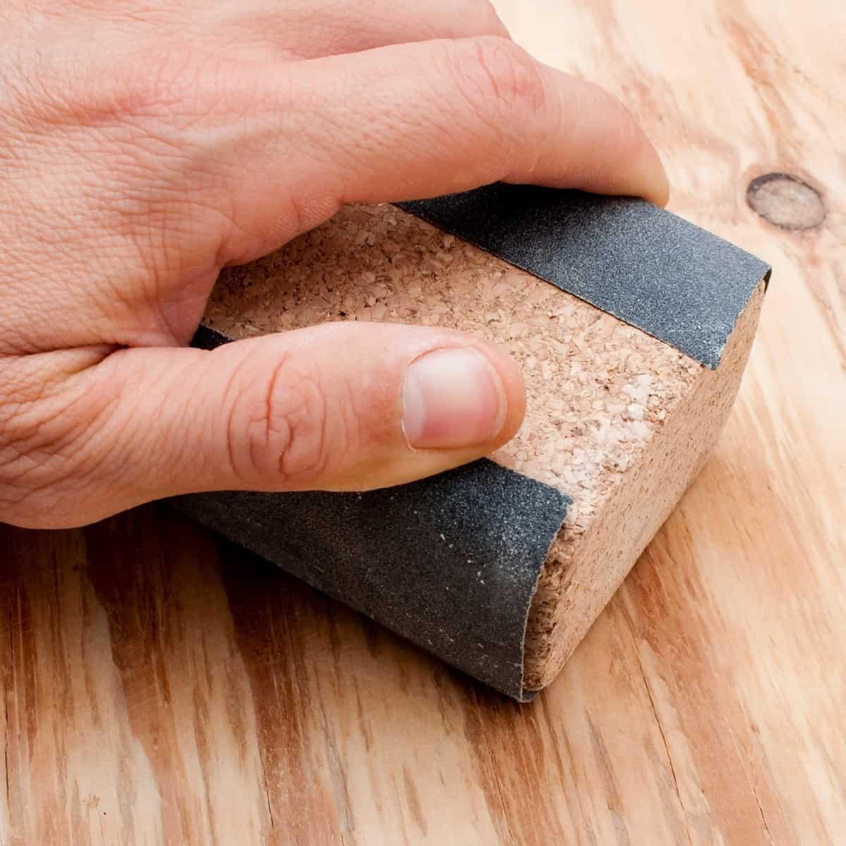 hand wrapped around sanding block