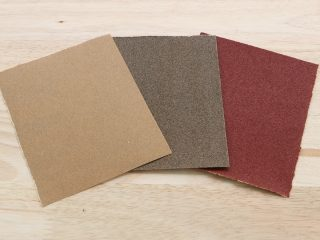 squares of sandpaper on wood surface