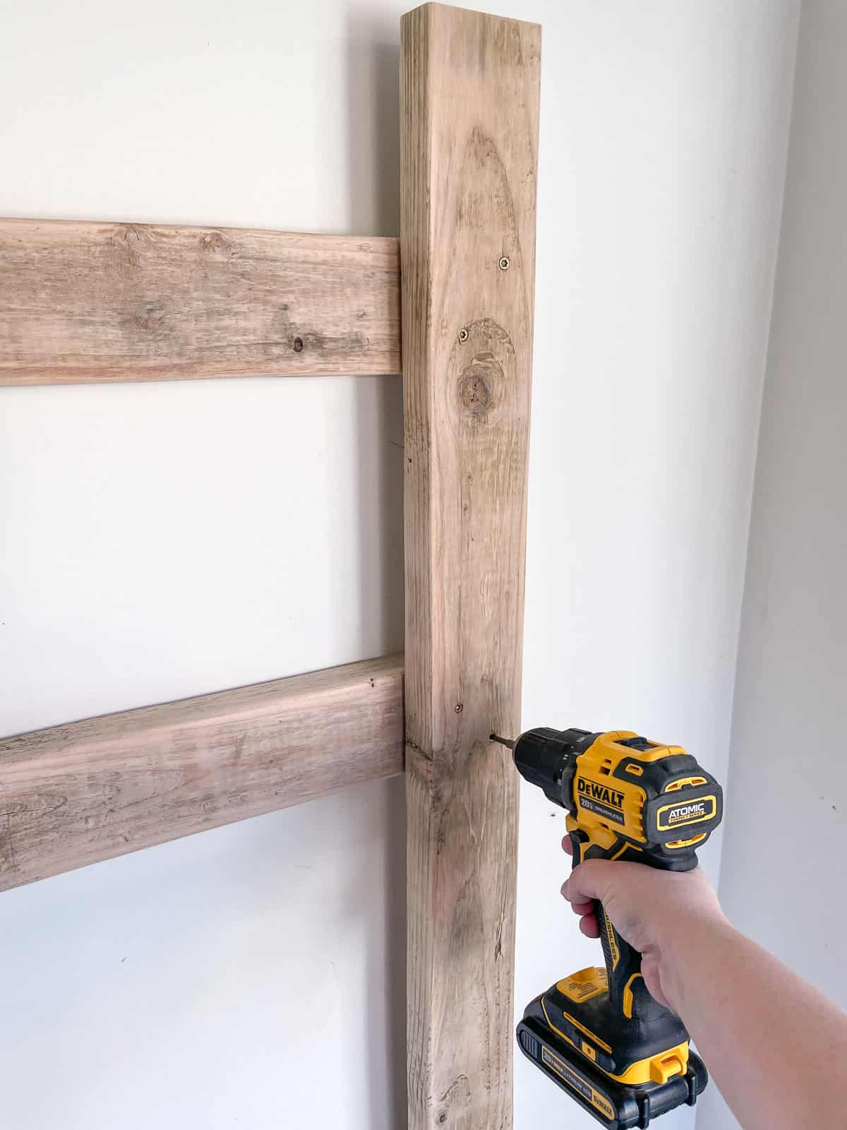 attaching vertical bike rack to horizontal supports on the wall