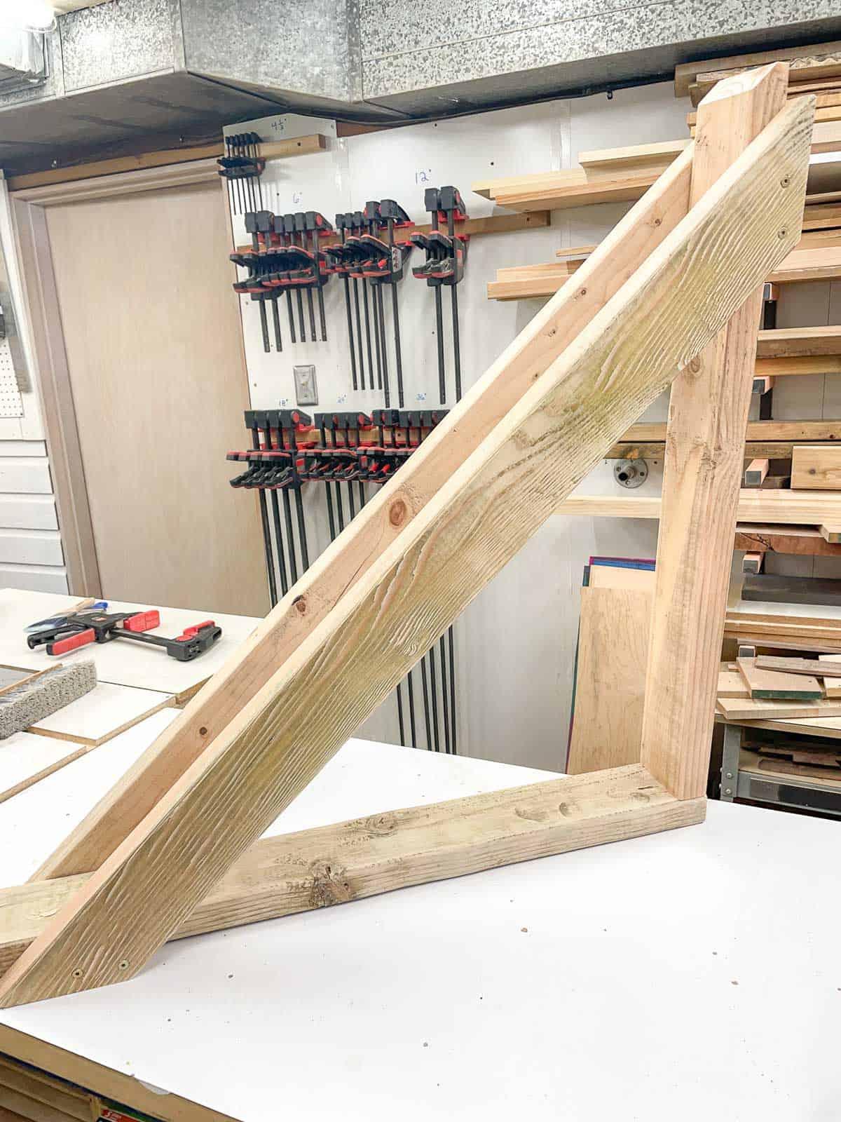 DIY wood bike rack assembled on workbench
