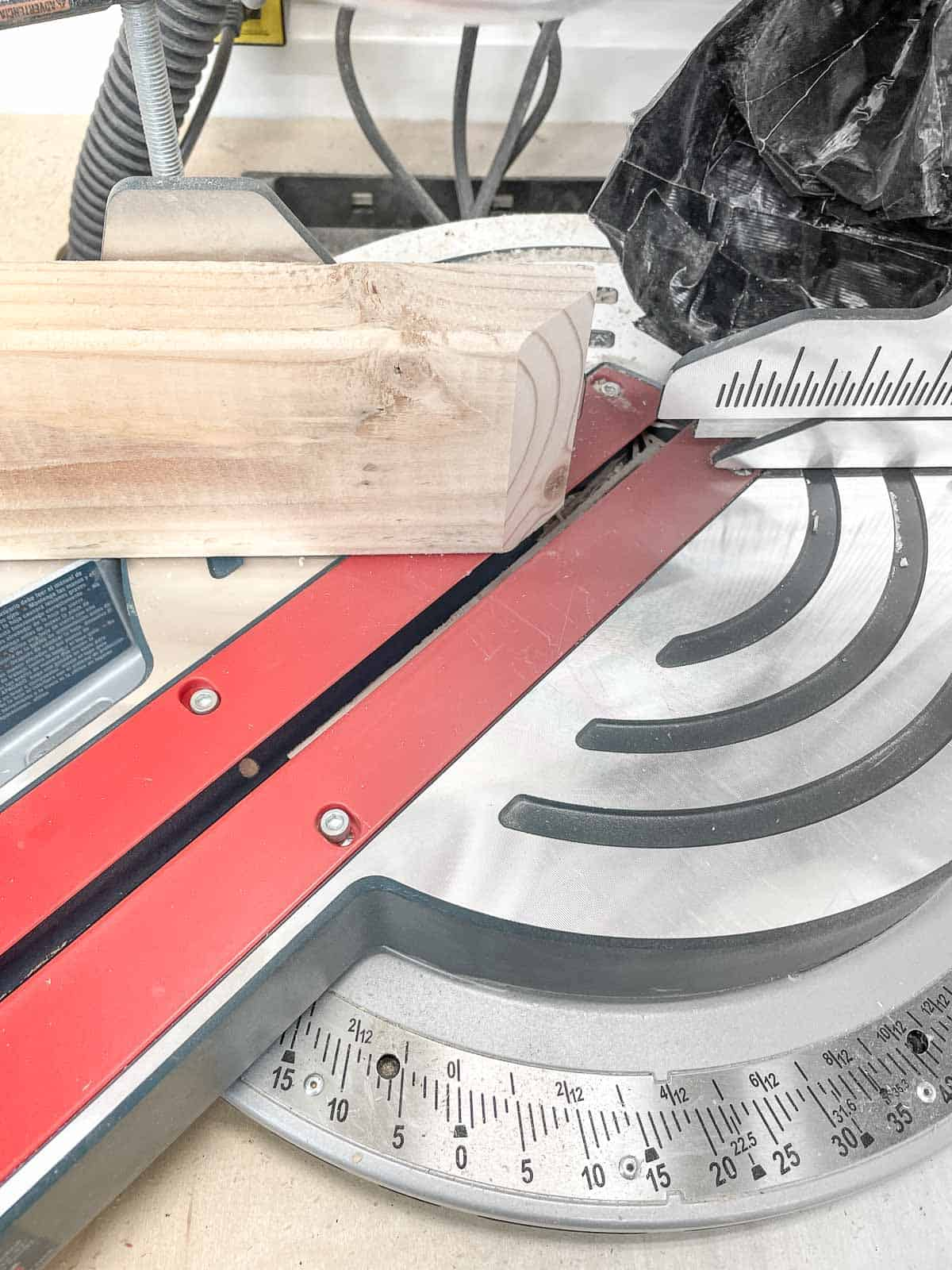 trimming corner of bike rack bottom with a miter saw