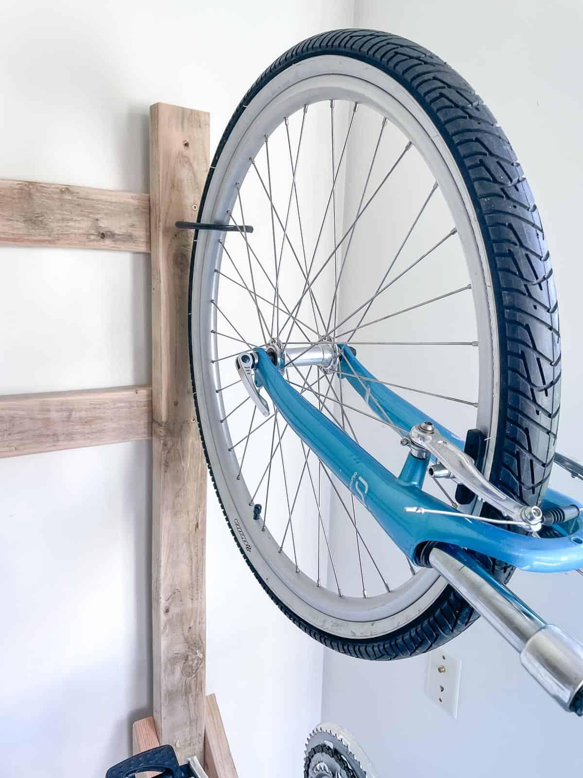 2x4 bike rack with wheel on hook