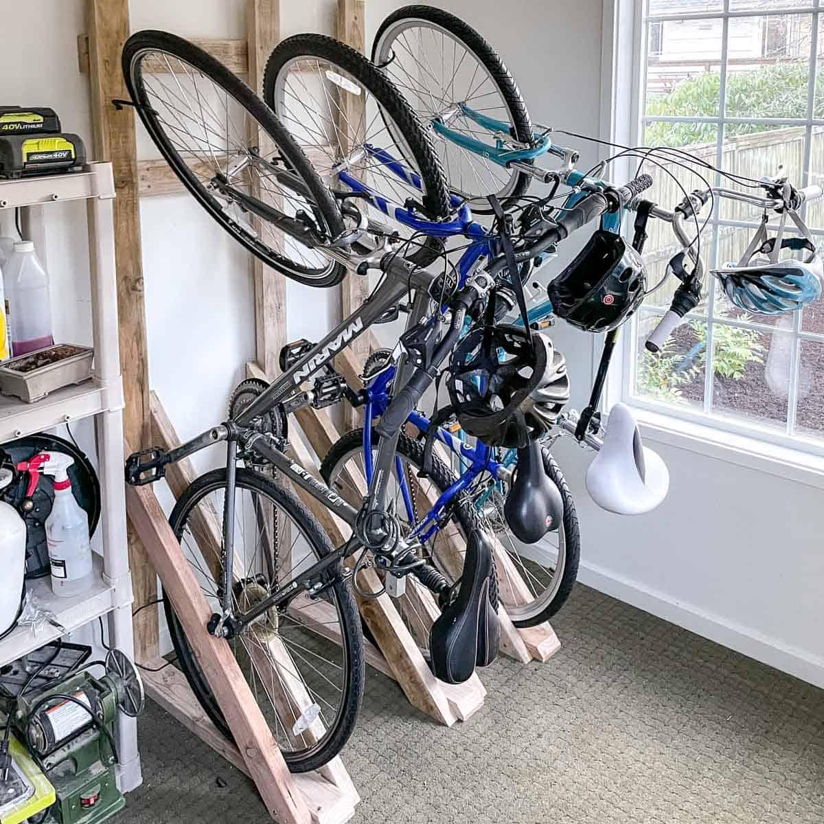 DIY bike rack on wall of shed