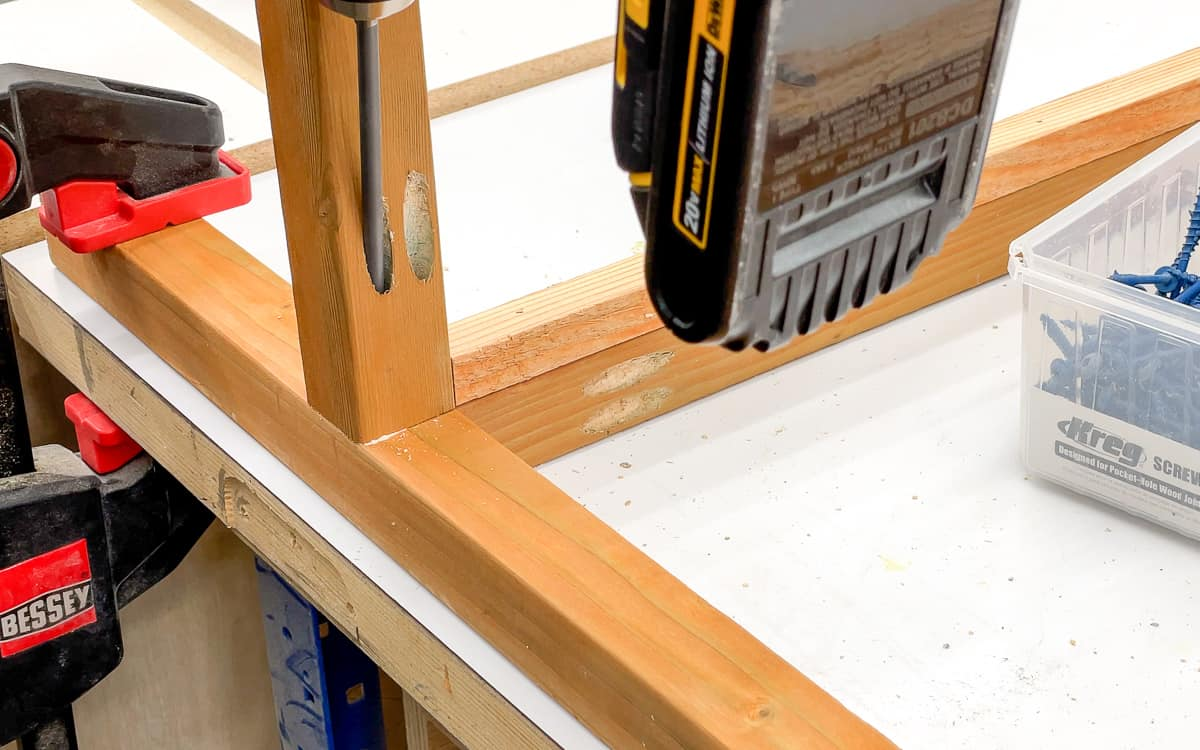 attaching the cross supports to the DIY mini greenhouse frame with pocket hole screws
