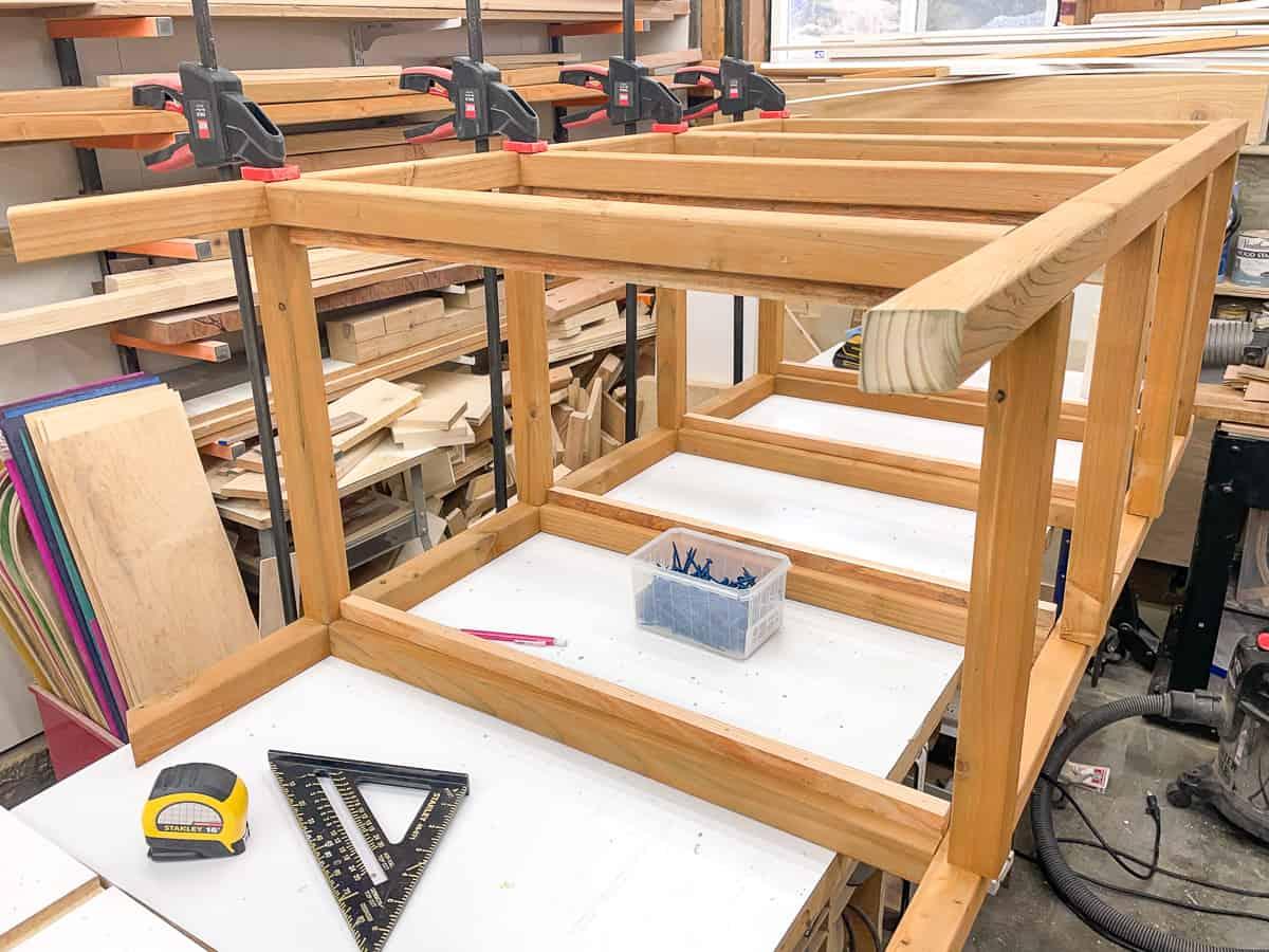DIY mini greenhouse frame assembled on workbench