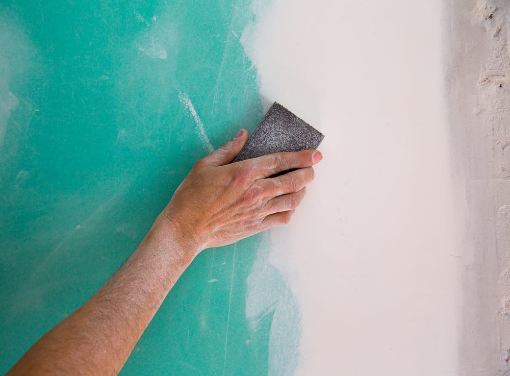 sanding drywall seam with sanding block