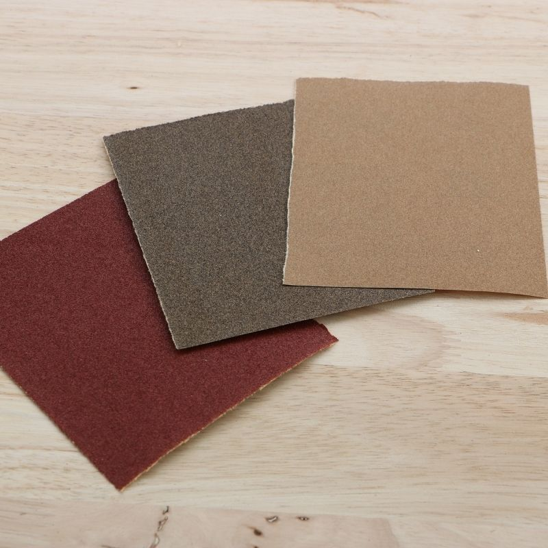 red, brown and tan squares of sandpaper