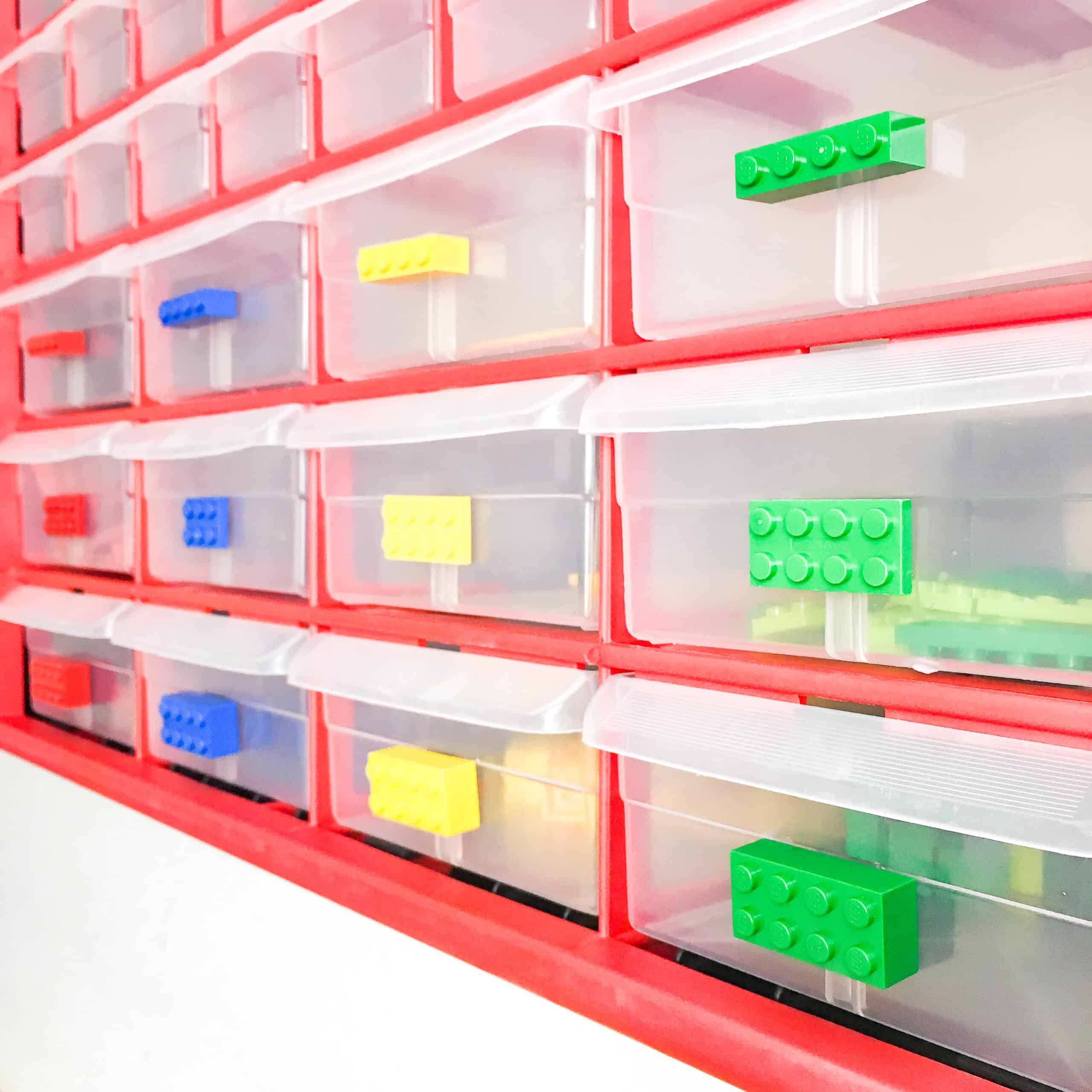 small parts bins with a Lego piece attached to each drawer
