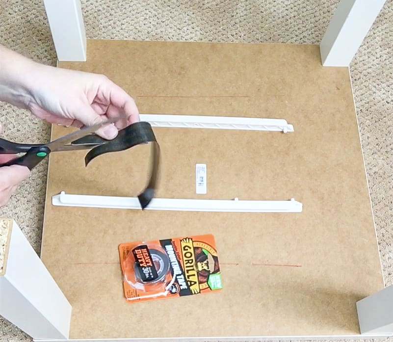 cutting double sided tape to attach drawer to underside of Lego table