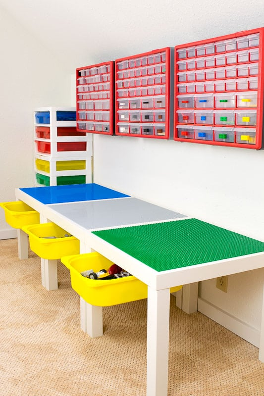 DIY Lego table with drawers open and wall mounted small parts bins above