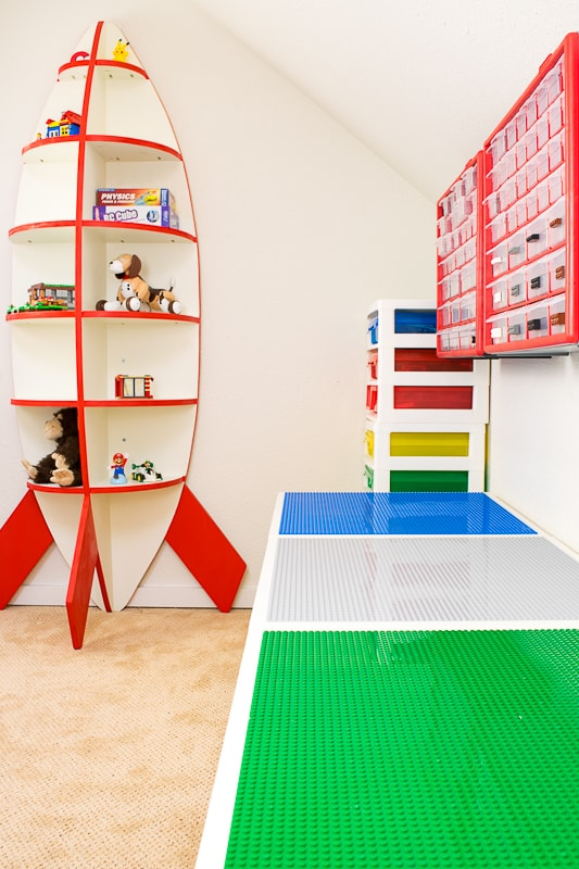 DIY Lego tables against the wall with rocket bookshelf in the background
