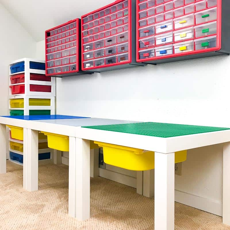 three Lego tables connected with Velcro with part storage above
