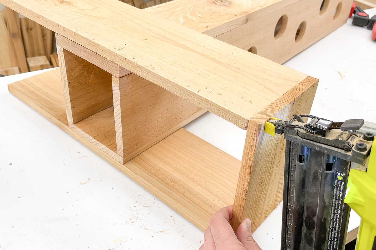 attaching ends of the strawberry planter base with a brad nailer