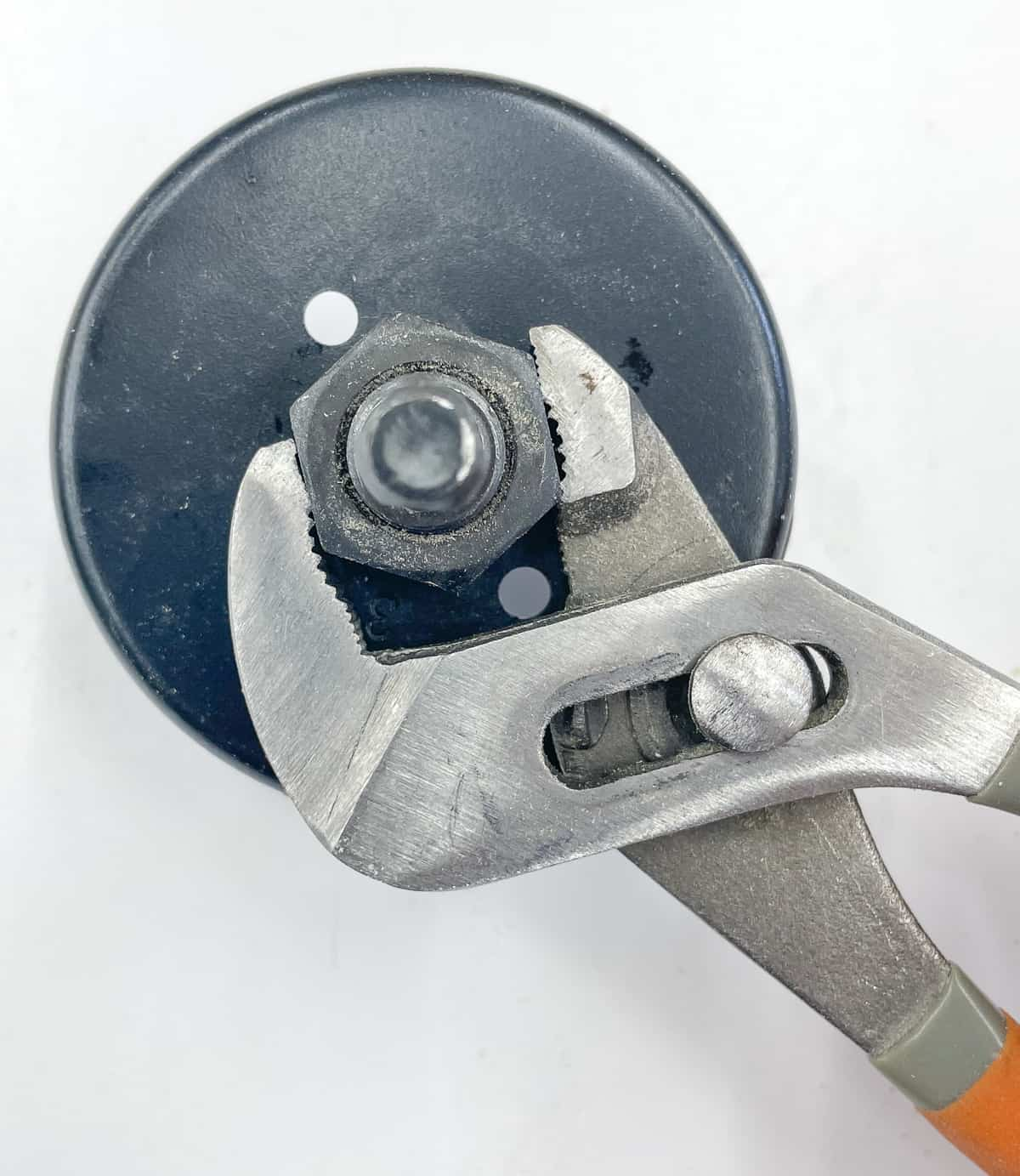 tightening hole saw nut with an adjustable wrench