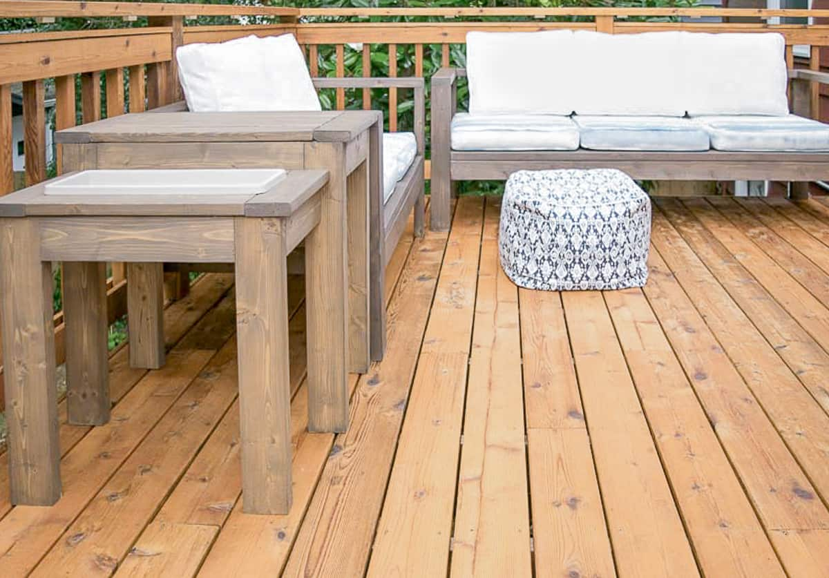finished stained deck with outdoor furniture in place