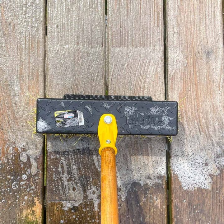scrubbing deck with homemade deck cleaner