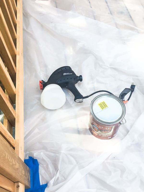 plastic sheeting covering deck surface with supplies on top
