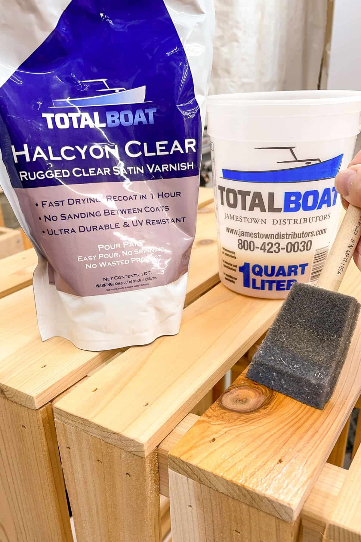 applying Total Boat Halcyon Clear varnish to completed planter box