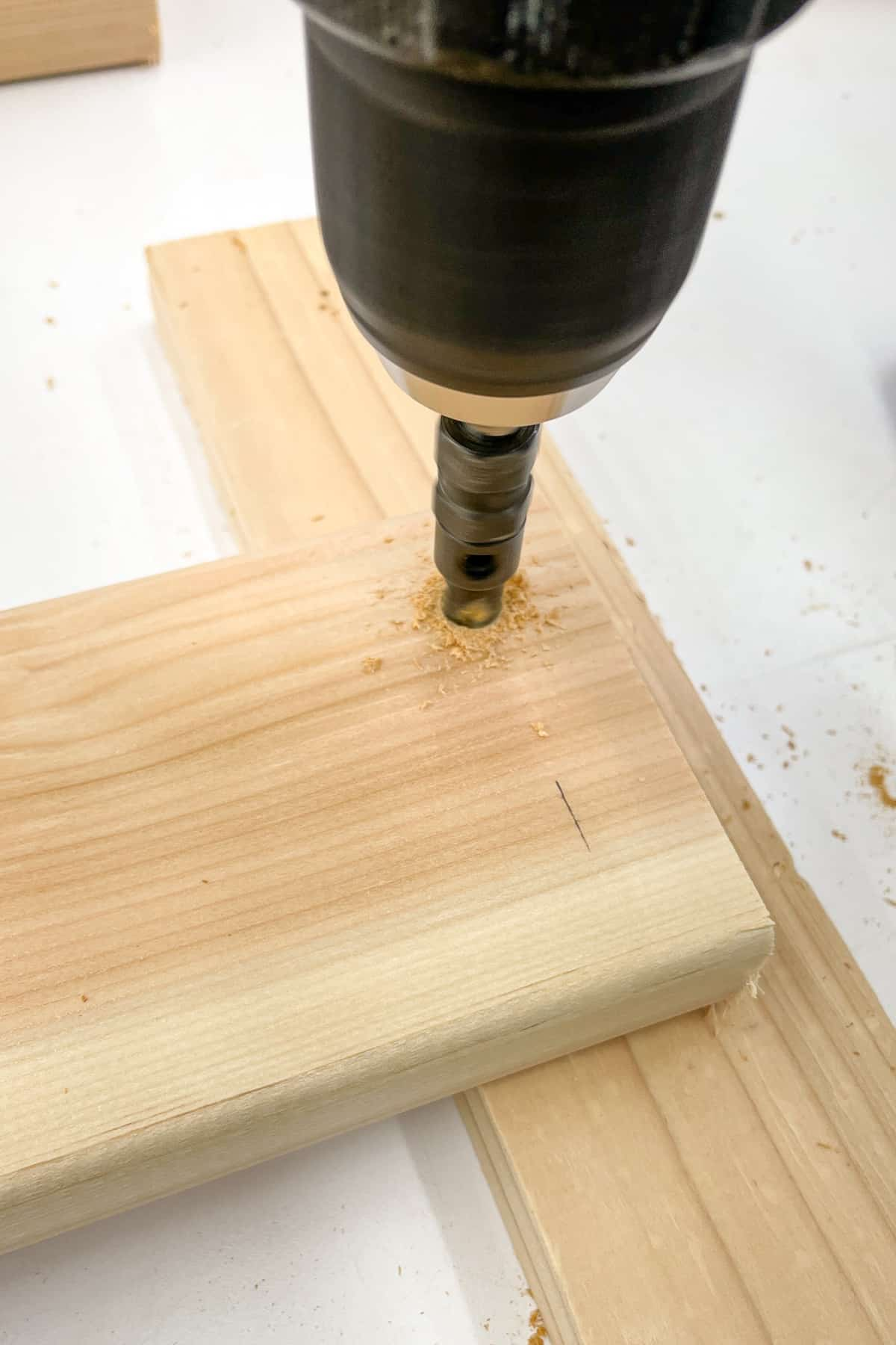 drilling a countersink hole in the ends of the plant shelf slats