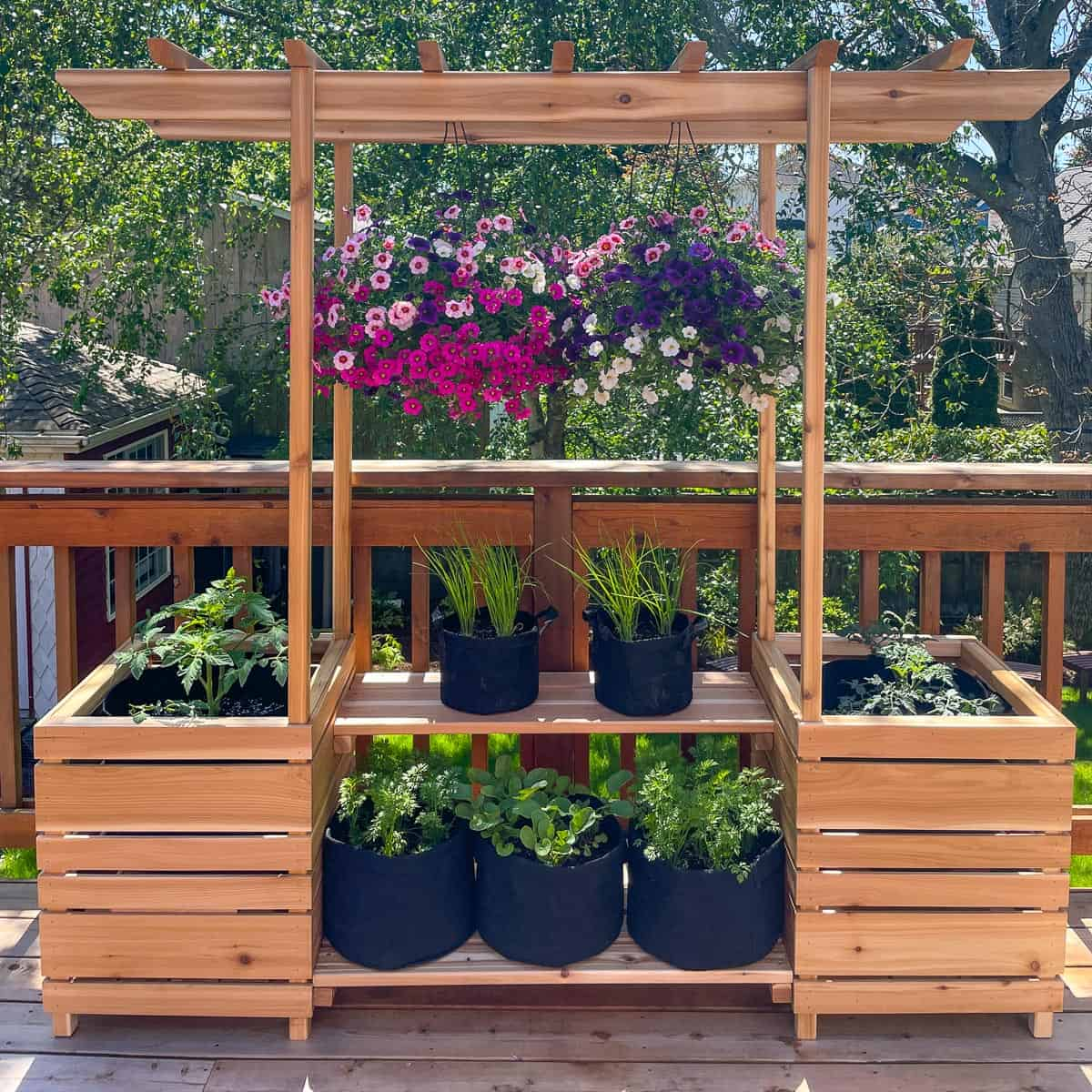 DIY outdoor plant stand with arbor, planter boxes and hanging baskets