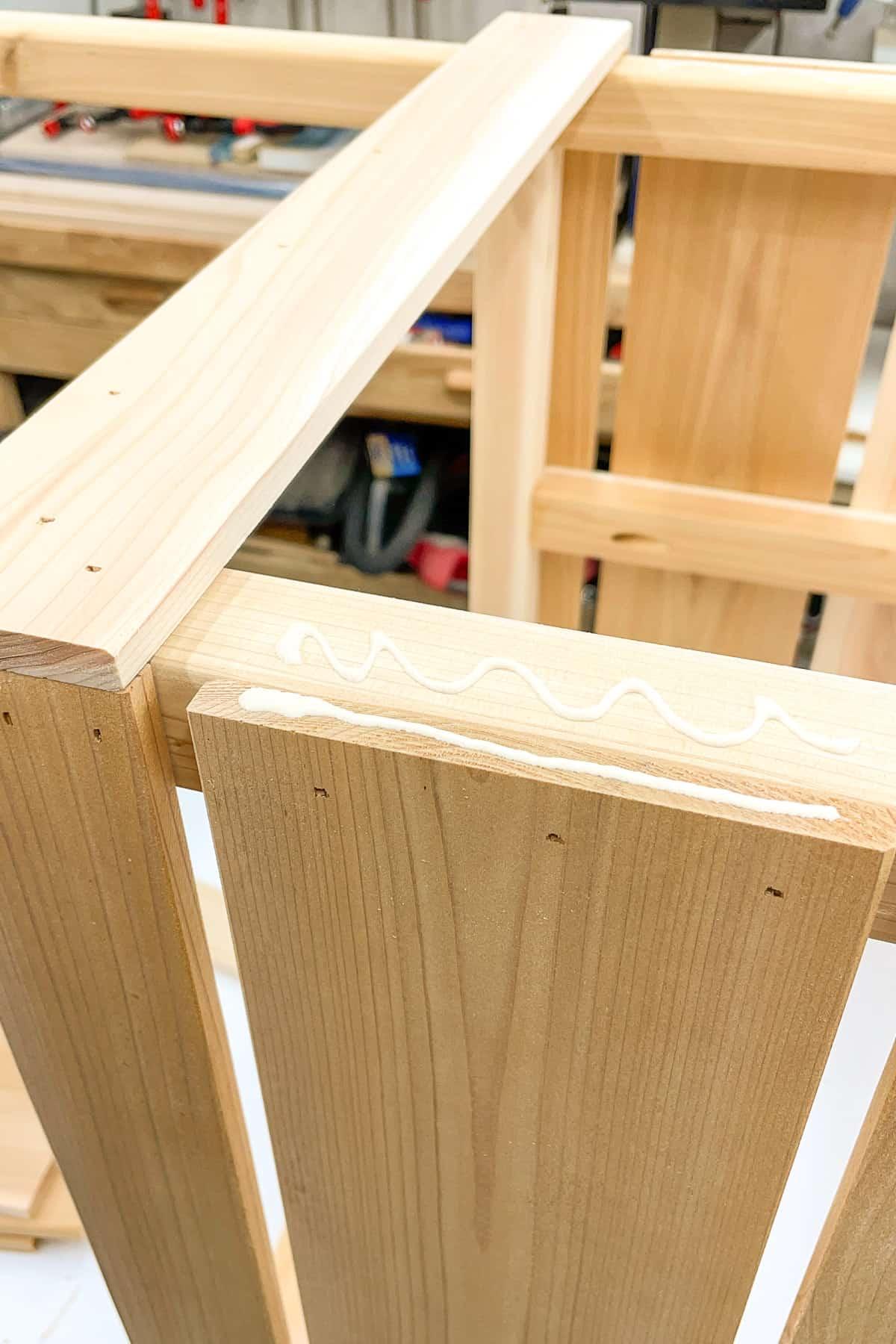 wood glue at joint between planter box slats and frame