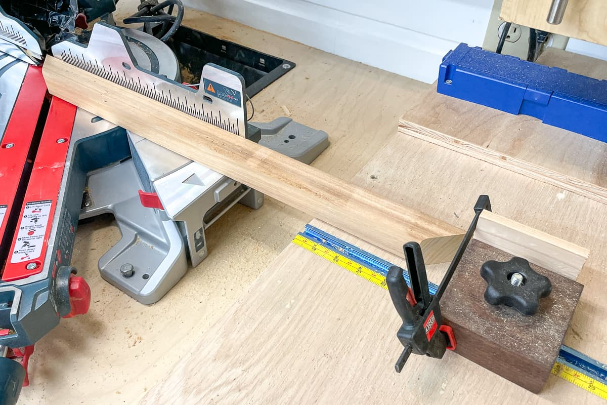 cutting the arbor ends with a miter saw and stop block