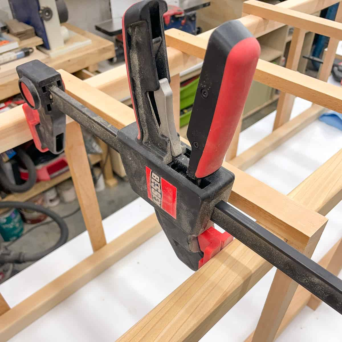 Bessey quick clamps acting as a spreader to align the slats of the wood tomato cage