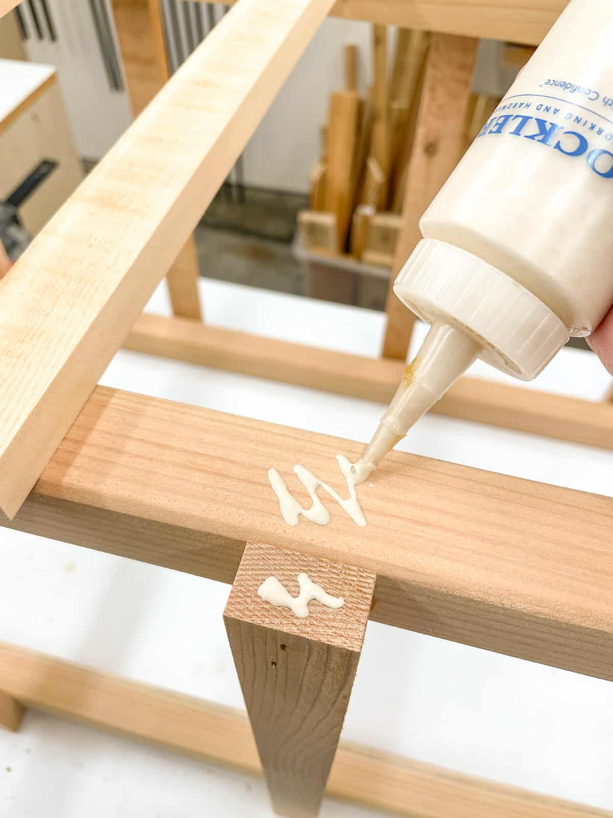 wood glue on joint between tomato cage slats