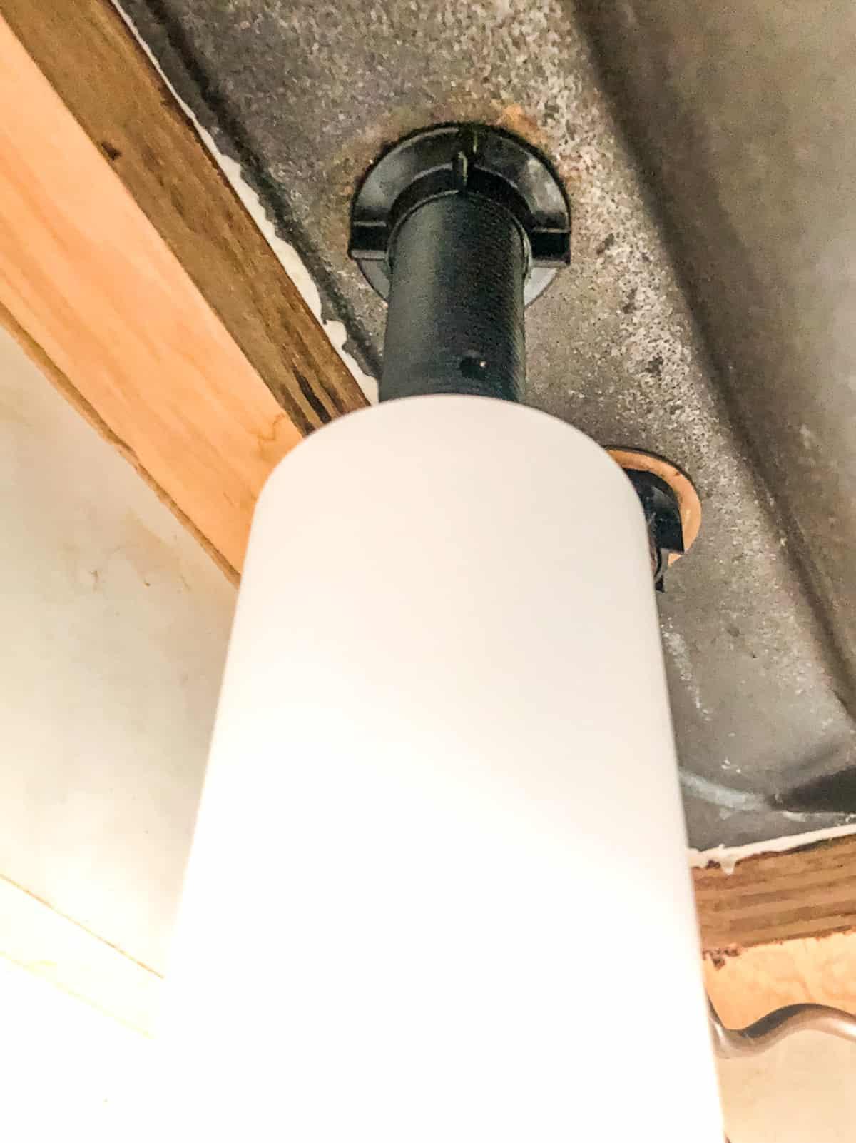built-in soap dispenser bottle under sink