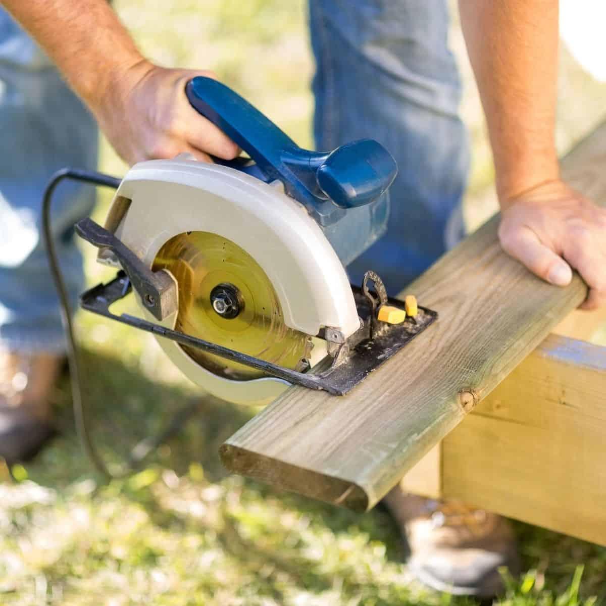 cutting a deck board with a circular saw