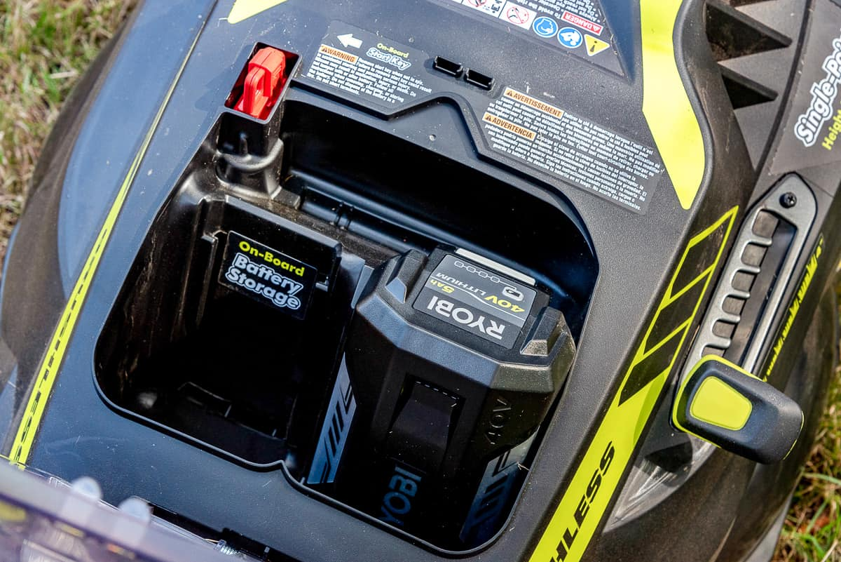 battery compartment on Ryobi electric lawn mower
