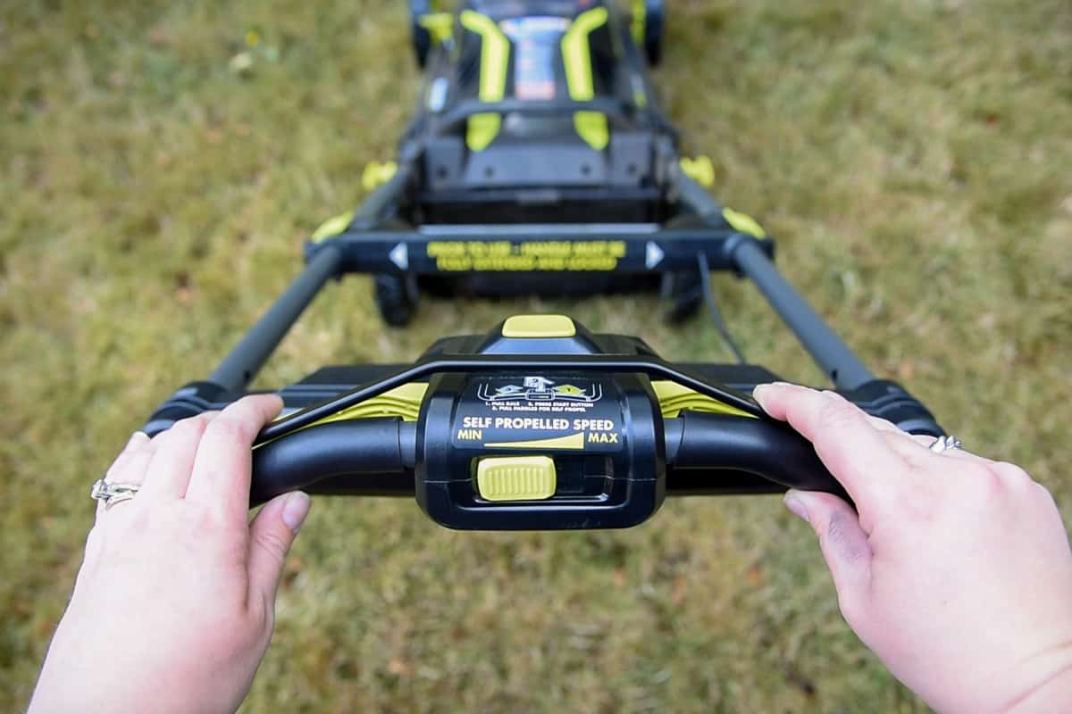 lower the bar before starting the Ryobi electric lawn mower
